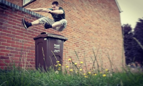 jumping over dustbin